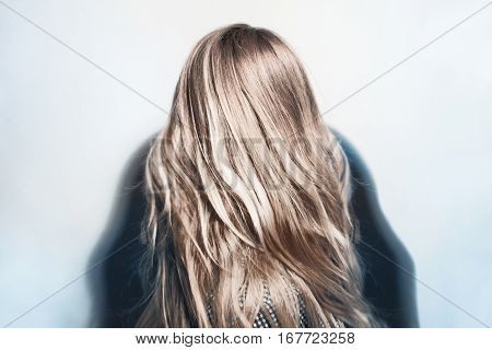 Beautiful healthy dyed blond hair of young woman