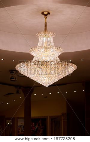 close up of a beautiful chrystal chandellier in a fancy restaurant