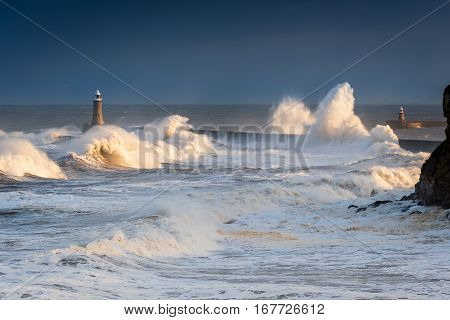 Rough Sea at Tynemouth, as stormy sea hits Tynemouth North Pier, resulting in high crashing waves cascading into the mouth of the River Tyne