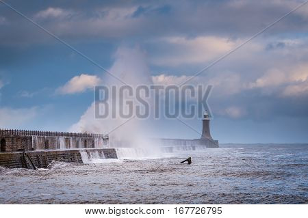 Storm Surge at Tynemouth Pier, as a stormy sea hits it, resulting in high crashing waves cascading into the mouth of the River Tyne