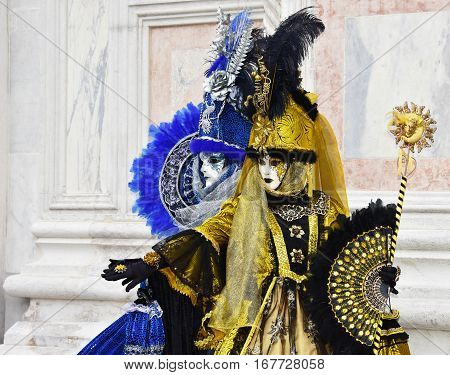 VENICE, ITALY - FEBRAURY 2: Carnival of Venice two beautiful masks with fan and scepter symbolize the sun and the moon FEBRUARY 2, 2016 in Venice, Italy
