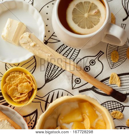hand carved wooden butter knife with breakfast
