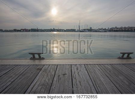 Idyllic sea view from a dock, sunset. Soft light pastel shades. Valencia port
