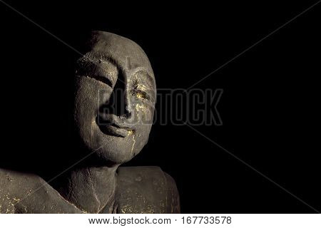 Traditional carved statue of an enlightened buddhist monk