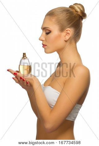 Young woman with perfume isolated
