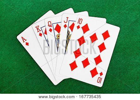 royal flush poker hand on felt texture