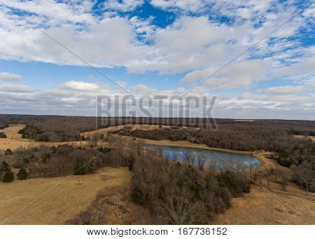 Aerial landscape of a small midwestern lake during a barren winter