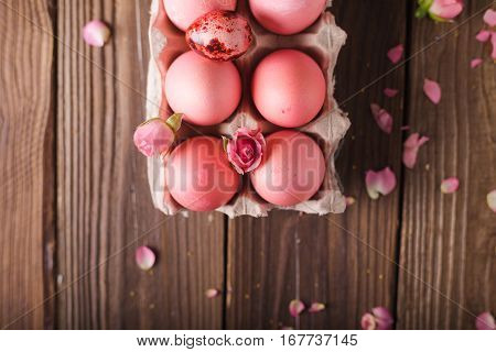 Pink Easter eggs on wodden background. Copyspace. Still life photo of lots of pink easter eggs.Background with easter eggs. Pink eggs and roses. Easter photo concept