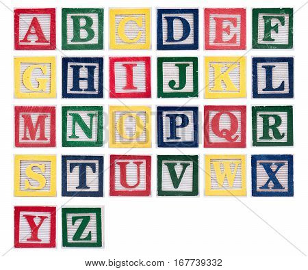 Letters in alphabet made of vintage rustic painted wooden blocks