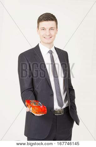 Car credit concept. Hand holding the model of car. symbol photo for car purchase