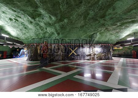 STOCKHOLM, SWEDEN - DECEMBER 26, 2016: Interior of Kungstradgarden subway station. Over 90 subway stations have been decorated with sculptures, mosaics, paintings and reliefs by over 150 artists