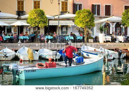 Desenzano Del Garda, Italy - September 23, 2016: Fisherman In A Boat In Desenzano Del Garda, A Town