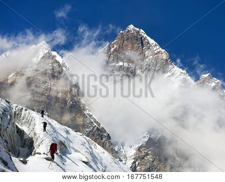 group of climbers on mountains montage to mount Lhotse Everest area Khumbu valley Nepal