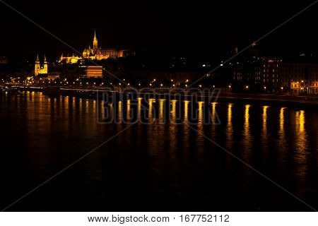 Night Few On Fisherman's Bastion And St. Matthias Church From The Side Of The Dunabe River, Budapest