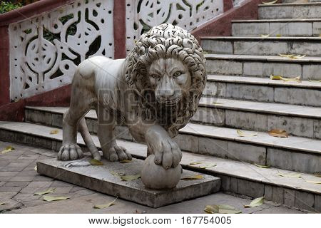 KOLKATA, INDIA - FEBRUARY 09: The lions guarding the entrance to the Sree Sree Chanua Probhu Temple in Kolkata, West Bengal, India on February 09, 2016.