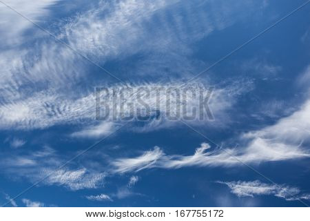 Wisp shape cirrus clouds on blue sky