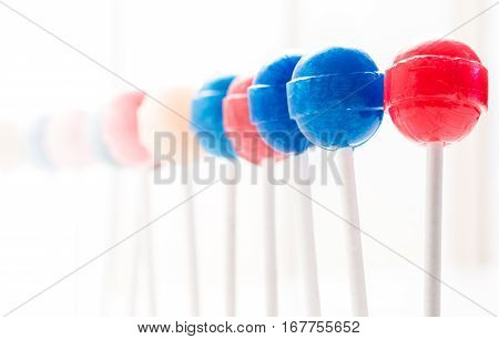 A row of lollipops of various colors shot from right