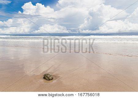 Waves sand beach and clouds sunny day on playa santa teresa costa rica