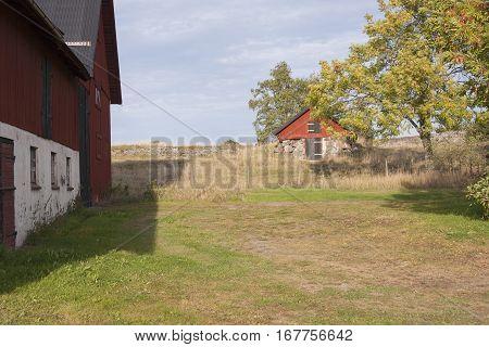 A big and a small farmhouse and a blue sky
