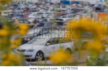 Blurry car park next to modern mall, use for background usage