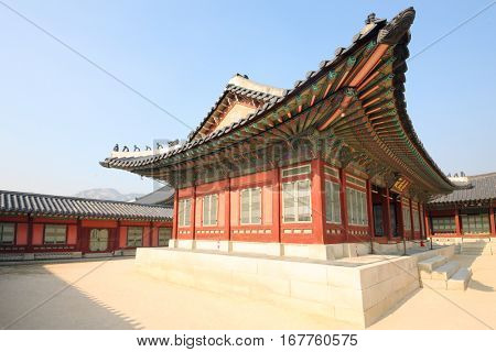 Houses with beautiful, decorated roof in Gyeongbokgung, Seoul at autumn day