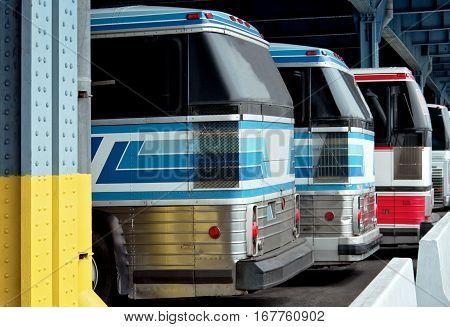 Public transportation, travel. A few buses under a canopy