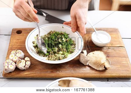 Healthy diet, green vegetables. Vegan dish. Cooking. Green diet. The cook prepares the dish.