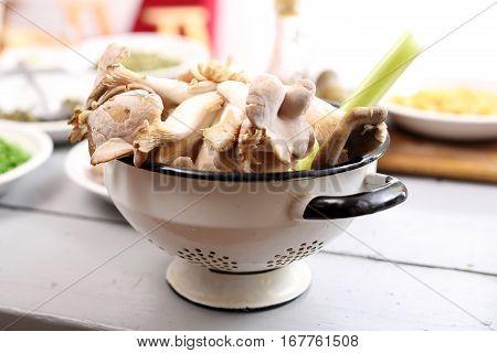 Oyster mushrooms mushrooms and olive oil. oyster mushrooms in the kitchen. Oyster dishes in the kitchen vegan. Oyster mushrooms, organic food. Oyster mushrooms on the kitchen table.