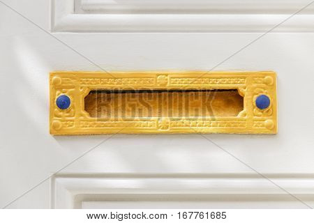 Old Colorful Letter Box in a White Door