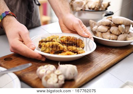 Oyster mushrooms coated in breadcrumbs. Vegan dish. Vegan dish. The cook prepares a dish dinner.
