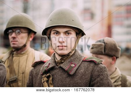 Gomel, Belarus - November 26, 2016: Portrait Of Young Unidentified Re-enactor Dressed As Red Army Russian Soviet Infantry Soldier Of World War II