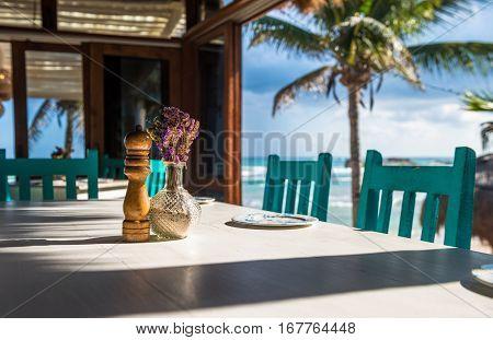 Seascape tropical beach restaurant  very shallow focus