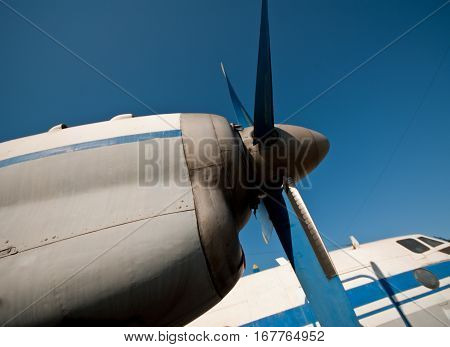 old propeller aircraft against the blue sky