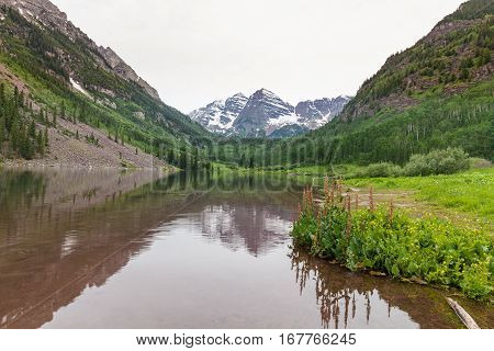 a scenic reflection of the Maroon Bells Aspen Colorado in summer