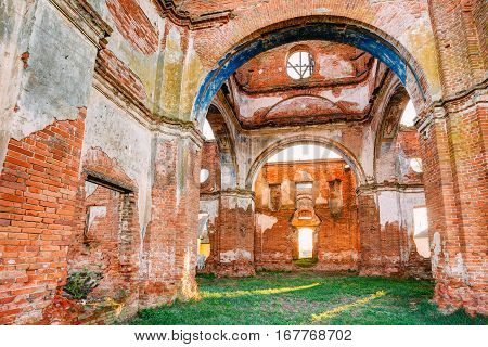 Red Brick Walls Of Old Ruined Orthodox Church Of The St. Nicholas In Village Lenino, Dobrush District, Gomel Region, Belarus