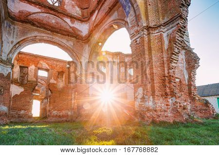 Sun Shines Through The Red Brick Walls Of Old Ruined Orthodox Church Of The St. Nicholas In Village Lenino, Dobrush District, Gomel Region, Belarus