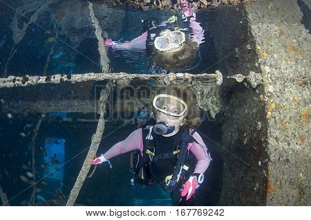 Diver with Reflection inside the SS Thistlegorm shipwreck near Ras Muhammed, Red Sea, Egypt.