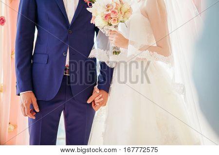 Bride And Groom Holding Hands Together