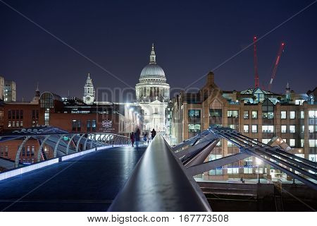 London, UK. 28th January 2017. People are walking towards St Pauls Cathedral over a central London bridge at night