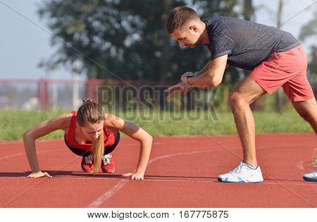 Fitness Woman Doing Push-ups During Outdoor Cross Training Workout.
