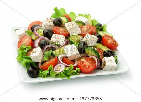 Square plate of greek salad isolated on white