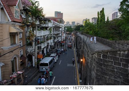 Manila, Philippines - March 7, 2016: view of street Muralla from the walls of Intramuros in Manila