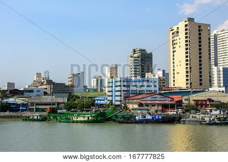 Manila, Philippines - March 7, 2016: Houses on the waterfront of the river Pasig in Manila