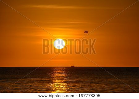 Parachutist on background of a sunset over the sea, Boracay, Philippines