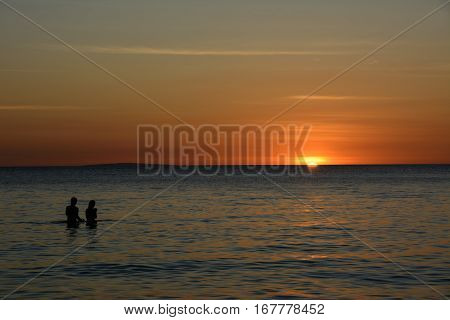 People watching the sunset over the sea on Boracay Island, Philippines