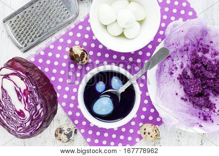 Dyeing Easter eggs with natural dye colors - red cabbage blue Easter eggs preparation