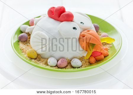 Easter chicken cake decorated fondant chocolate candy eggs and cookies crumbs