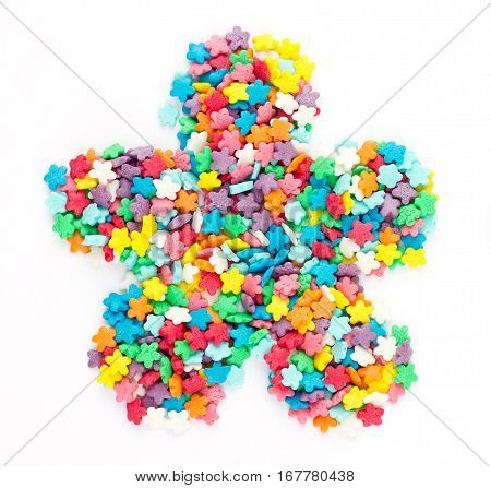 Colorful sugar sprinkles shaped flower isolated on white background