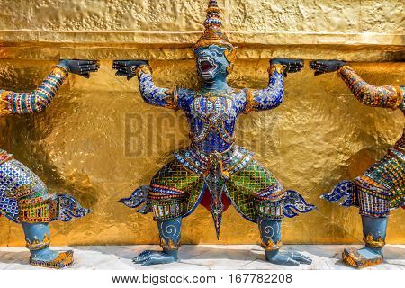 Sculpture of a Thotsakhirithon or giant demon Yaksha at the Emerald Buddha Temple in Bangkok