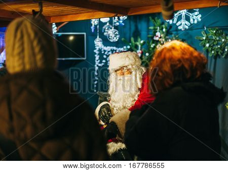 STRASBOURG FRANCE - DEC 20 2016: Santa Claus being admired by visitors of the oldest Christmas Market in Strasbourg France